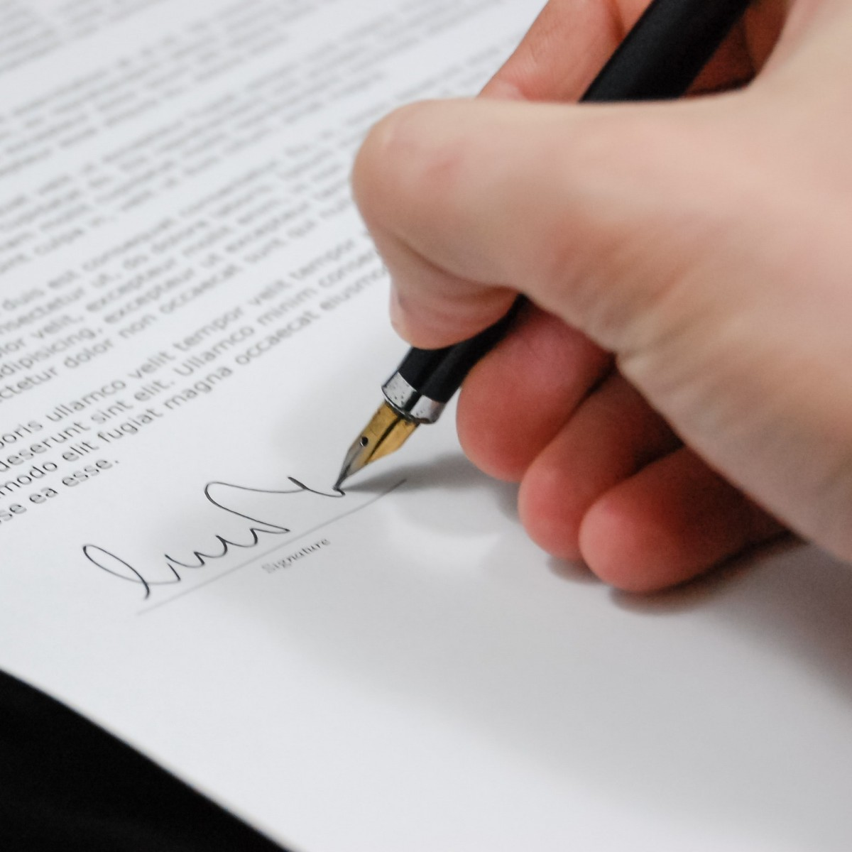 Photo of signature with black pen in important document